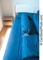 Blue bedroom with wooden floor
