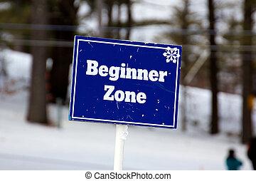 Blue Beginner Zone Sign on the Ski Slopes - Sign marking the...