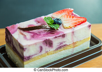 Blue berry cheese cake on wooden plate 6
