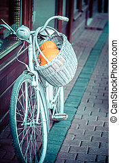 Blue bicycle in local Amsterdam street.