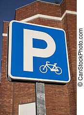 Blue bicycle sign in urban setting
