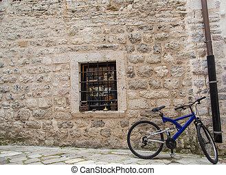 Blue Bike on Old Stone Wall