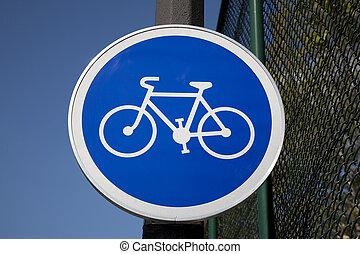 Blue Bike Sign in Urban City Setting