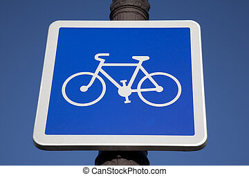 Blue Bike Sign on Sky Background
