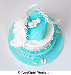Blue birthday cake for baby. First kid birthday.