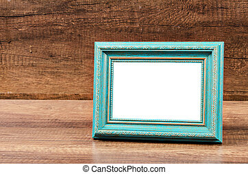 Blue blank photo frame on wooden room.