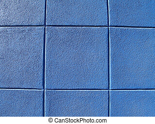 Blue exterior concrete block wall in a tic-tac-toe pattern.