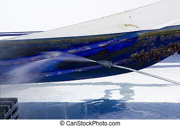 blue boat hull cleaning pressure washer barnacles antifouling and seaweed