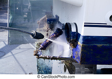 blue boat hull cleaning pressure washer barnacles