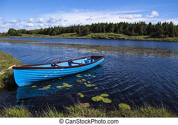Blue boat in a lake, Connemara Ireland