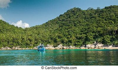 Blue boat in the bay