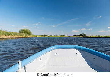 Blue boat on river