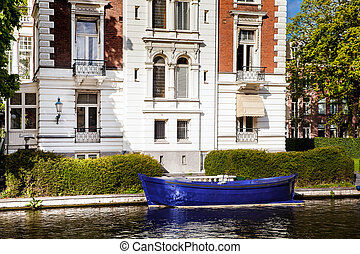 Blue boat on the canal of Amsterdam