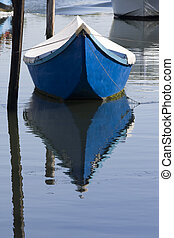 Blue boat on water