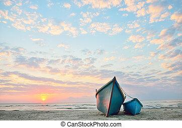 Blue boats on beach