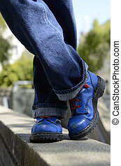 Blue boots - legs only of a man wearing blue jeans and blue ...
