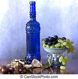 Blue bottle with grapes