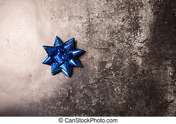 blue bow on a gray background
