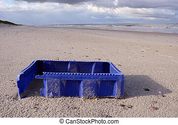 blue box after storm on sea beach