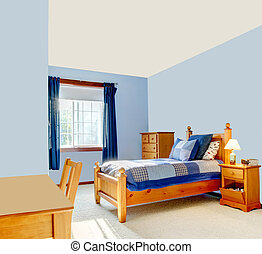 Blue boys room with wood bed and curtains.