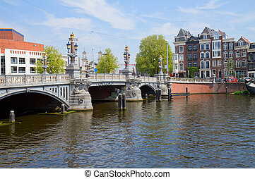 Blue bridge of Amsterdam on Amstel river, Netherlands