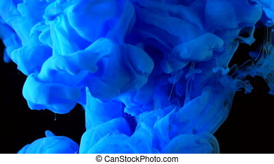Blue brilliance ink in water shooting with high speed...