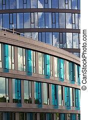 Blue brise soleil sun breakers on modern office glass building