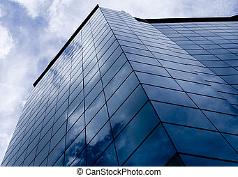 Blue Buildings 2 - The blue sky reflects in the glass of a...