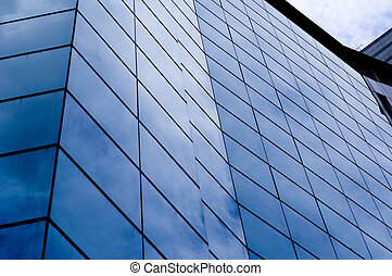 Blue Buildings - The blue sky is reflected in the glass of...