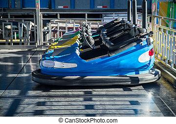 blue bumper cars - Row of bumper cars at a fair