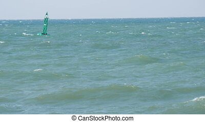 Blue buoy swings on waves in sea - Blue buoy swings on waves...