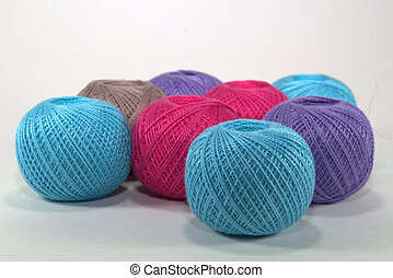 blue, burgundy, purple and brown tangles of natural cotton on a white background in loose form