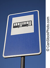 Blue Bus Stop Sign on Blue Sky Background