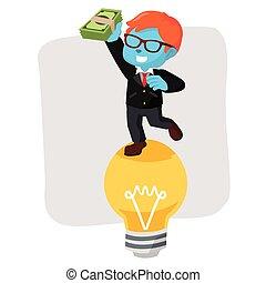 blue businessman on bulb holding money