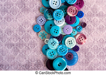 Blue buttons on grungy wallpaper