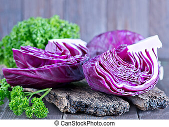blue cabbage on board and on a table