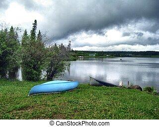 Blue canoe on shore.