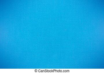 blue canvas background, woven fabric texture, closeup