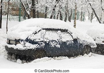 Blue car in snowfall