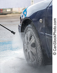 Blue car wash using high pressure water jet.