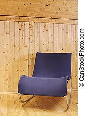 Blue chair in wooden minimalist interior