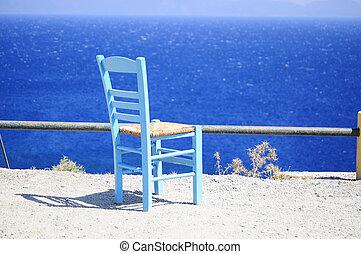 Blue chair near sea