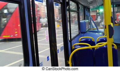 Blue chairs on the inside of the bus