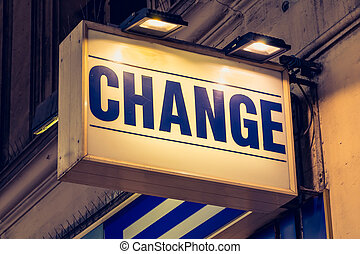 blue change signboard in a street of Paris
