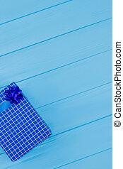 Blue checkered gift box.