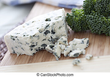 Blue Cheese - Blue cheese on cutting board with other...
