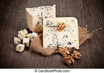 Blue cheese on wooden table