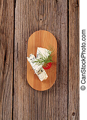 Blue cheese - Pieces of blue cheese on a cutting board