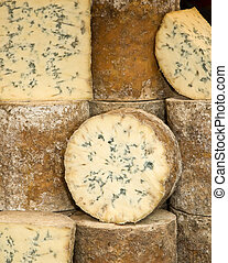 Blue Cheese - Wheels of blue cheese in a market