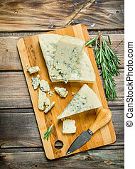 Blue cheese with branches of fragrant rosemary.